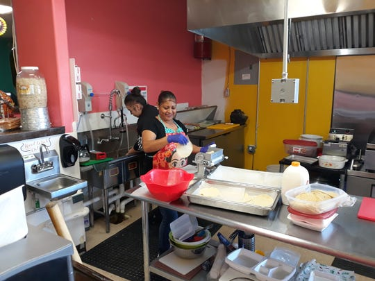 Employees at Taqueria Las Catrinas prepare homemade tortillas in the open kitchen on Tuesday, Nov. 26, 2019.