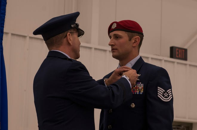 U.S. Air Force Lt. Gen. Jim Slife, left, commander of Air Force Special Operations Command, presents a Silver Star Medal to U.S. Air Force Tech. Sgt. Cody Smith, a Special Tactics combat controller with the 26th Special Tactics Squadron, during a ceremony at Cannon Air Force Base, New Mexico, Nov. 22, 2019. Smith was awarded the nation's third highest medal against an armed enemy of the United States in combat for his actions while deployed to Afghanistan in October 2018.