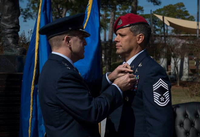 U.S. Air Force Lt. Gen. Jim Slife, commander of Air Force Special Operations Command, pins the Silver Star Medal onto U.S. Air Force Chief Master Sgt. Chris Grove, a Special Tactics combat controller assigned as the 720th Special Tactics Group superintendent, during a ceremony at Hurlburt Field, Florida, Nov. 15, 2019. Grove was awarded the nation's third highest medal against an armed enemy of the United States in combat for his actions while deployed to Afghanistan in November 2007. Grove was originally awarded the Bronze Star with Valor, but his award package was reviewed and resubmitted for an upgrade.