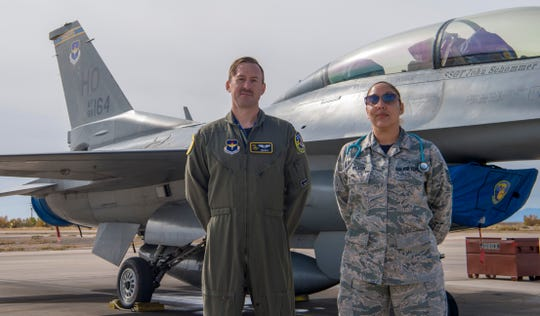 Capt. Bradley Brown, 311th Fighter Squadron flight surgeon, and Tech Sgt. Raquel Wilson, 311th FS independent duty medical technician, pose for a portrait, Nov. 8, 2019, on Holloman Air Force Base, N.M. Medical personnel work in-house and are trusted to keep the aircrew physically capable of carrying out the Holloman mission, producing operationally-ready aircrew.