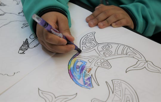 A pair of orcas are among the illustrations in the coloring book developed by Ms. Indigenous San Juan College Marie J. Nickoli.