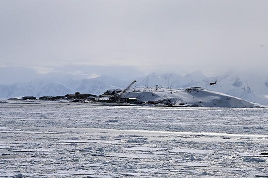 A plane comes in for landing at the UK's Rothera Station, the largest British Antarctic research station and hub for their field programs, located on the back side of Adelaide Island on Marguerite Bay.