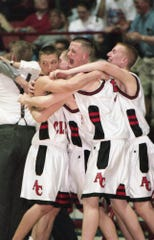 Annville-Cleona basketball players (l-r) Isaac Custer, Matt Kleinfelter, Jeff Browning and Vince Hoover celebrate after the Little Dutchmen defeated Quaker Valley 69-57 in double overtime for the PIAA Class AA state championship in 1999. Annville-Cleona will celebrate the 20th anniversary of the state title run on Dec. 13 during its home opener.