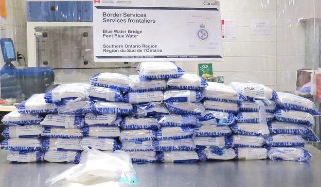 50 packages of suspected cocaine seized by the Canada Border Services Agency at the Blue Water Bridge in Point Edward, Ontario, on Nov. 18, 2019.