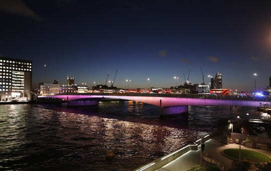 Abandoned buses and other vehicles are parked after an incident on London Bridge in London, Friday, Nov. 29, 2019. British police shot a man on London Bridge in the heart of Britain's capital on Friday after a stabbing that left several people wounded. (AP Photo/Frank Augstein)