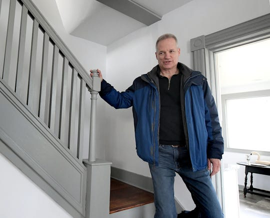 Chris Izzo, president of the Northeastern Foundation, descends a staircase, Friday, Nov. 29, 2019, in an East Manchester Township house the foundation purchased with the intent to resell. The foundation and local businesses provided upgrades to the property and it's debut open house occurred early in November. proceeds from the sale will benefit the Northeastern Foundation, which provides financial and academic support to Northeastern School District students. Bill Kalina photo