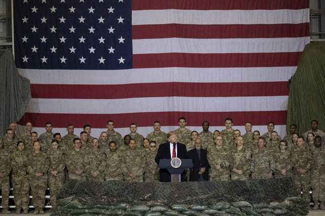 President Donald Trump addresses members of the military during a surprise Thanksgiving Day visit, Thursday, Nov. 28, 2019, at Bagram Air Field, Afghanistan. (AP Photo/Alex Brandon)