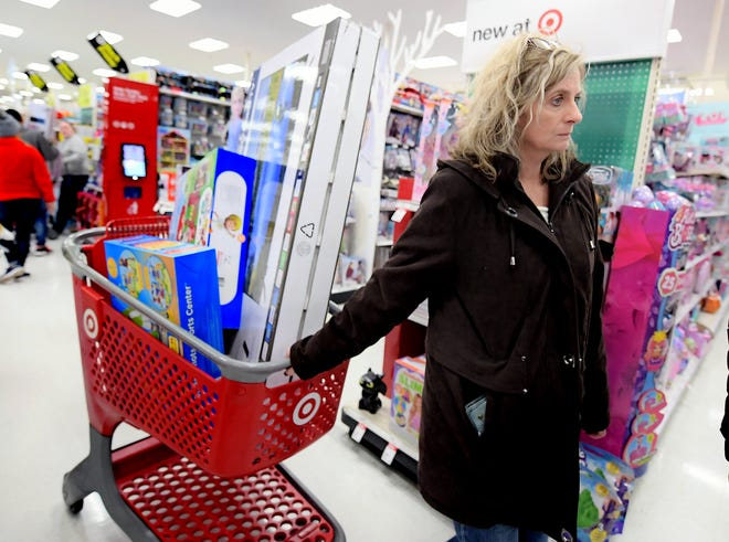 Vicki McDaniel of York Township pulls a cart full of items while shopping at the West Manchester Township Target Thursday, Nov. 28, 2019.
