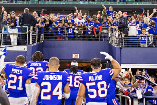Fans of the Buffalo Bills cheer for their team after a game on Thanksgiving Day against the Dallas Cowboys at NRG Stadium on Nov. 28, 2019, in Arlington, Texas. The Bills defeated the Cowboys 26-15.