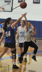 Gabby Trippi, left, and April Washburn get their reps during a recent Honeoye basketball practice.