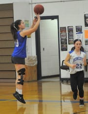 Gabby Trippi takes a shot during a recent practice with the Honeoye basketball team.