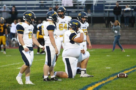 At 7-feet, 1-inch, Victor's Connor Williams taking a knee is essentially on an equal level with defensive line teammates like the 5-10 Dylan Sasso (76) and the 5-11 Michael Bowman. In the back is Sam Castiglia, who is 6-5 and David Kelley, (6), is 5-9.