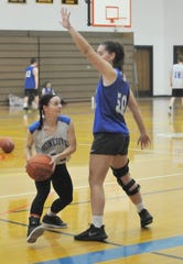April Washburn, left, is guarded by Gabby Trippi during a recent basketball practice at Honeoye.