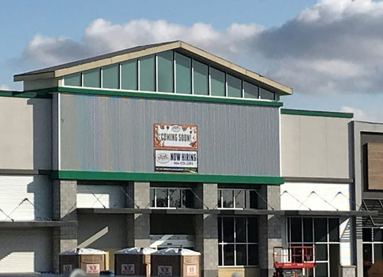 A banner on the spot where Sprouts Farmers Market will be in the Mt. Shasta Mall announces the company is hiring,