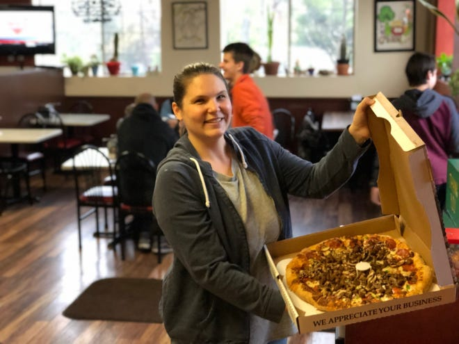 Caitlin Pearson with the Sundial Supreme pizza at Redding's Ultimate Pizza off Placer Street.