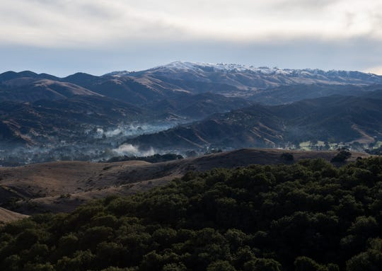 The mountain tops near highway 68 are covered with snow. The photograph was taken early morning on Nov. 28, 2019.
