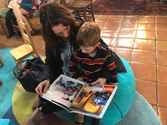 A mother reads to her son at Old Town Books, 506 S. Chadbourne St., on opening day Friday, Nov. 29, 2019.