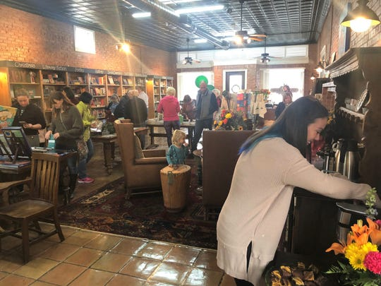 Customers fill Old Town Books at 506 S. Chadbourne St. on opening day, Friday, Nov. 29, 2019.