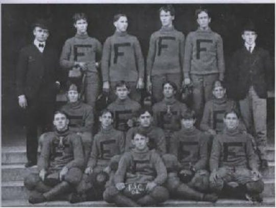 FSU's 1902 football team. Coach W.W. Hughes, left on the third row