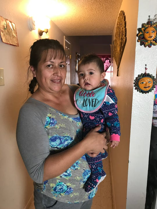 Fabens resident Maribel Perez holds her youngest child, 6-month-old Odalis, in her apartment. Her three youngest children will receive new coats through Operation Noel.