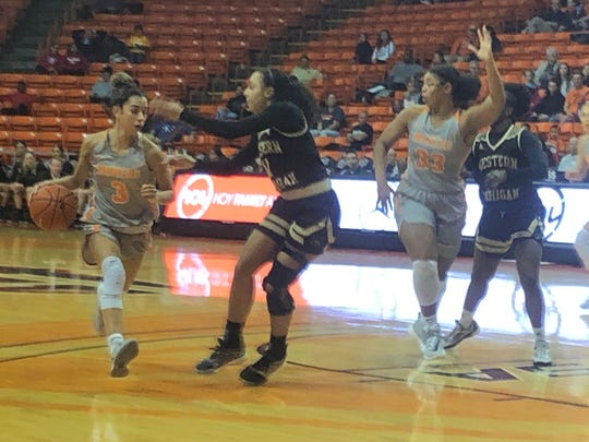 UTEP's Katia Gallegos drives against the defense of Western Michigan's Kamrin Reed while Michelle Pruitt tries to get open Friday, Nov. 29, 2019, at the Don Haskins Center