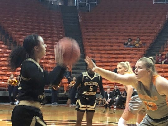 Western Michigan's Kamrin Reed looks for a passing lane against the defense of UTEP's Sabine Lipe on Friday, Nov. 29, 2019, at the Don Haskins Center