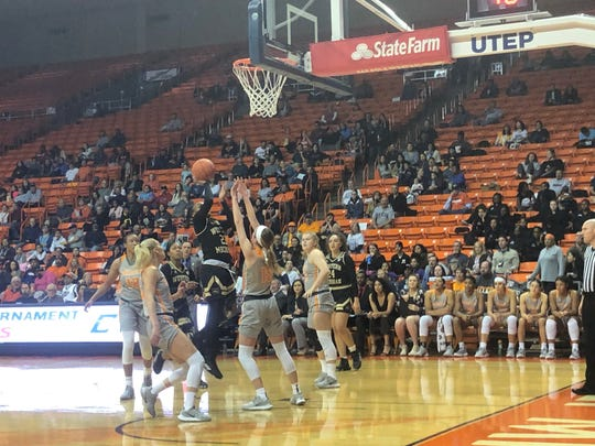 Western Michigan's Jordan Walker shoots against the defense of UTEP's Avery Crouse on Friday, Nov. 29, 2019, at the Don Haskins Center
