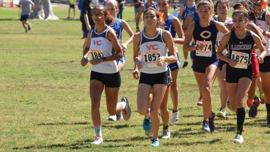 Sophomores Olivia Burton (left) and Brienna Tafoya finished second and third at the CCCAA women's cross country state championships on Nov. 23 in Fresno.