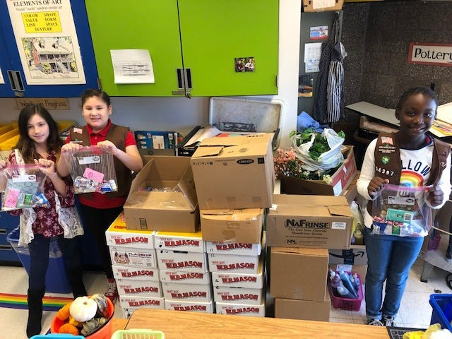 Members of the Mennies Elementary School family and Girl Scout Troop 54397 teamed up to complete a Blessing Bag service project to benefit cancer patients.