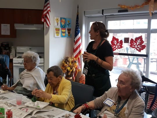Rutgers Master Gardeners share fun, holiday activity to residents of New Jersey Veterans Memorial Home.