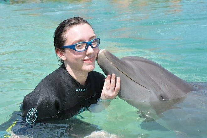 Make-A-Wish New Jersey granted Juliana of Buena's wish to swim with dolphins with help from funds donated by Big I New Jersey and Trusted Choice.