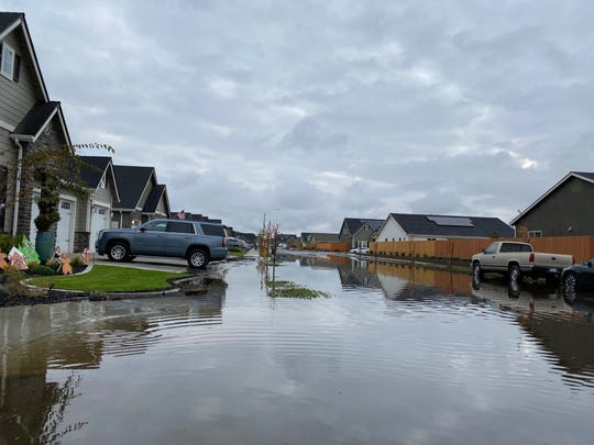 A winter storm deposited much-needed rain on the Valley floor this week, causing some Tulare County neighborhoods to experience light flooding.