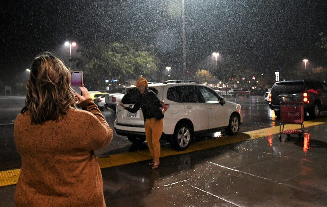 Emily Gonzales takes a photo of her sister in front of Tulare's Target on Thanksgiving.