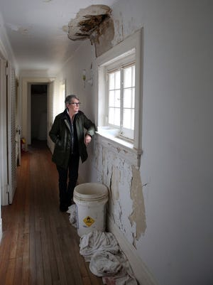 Legislator Kitley Covill looks out a window at the Merestead Estate in Mt. Kisco Nov. 27, 2019. The estate near Byram Lake is in need of repair.