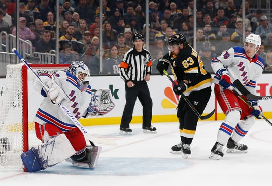 Nov 29, 2019; Boston, MA, USA; New York Rangers goaltender Henrik Lundqvist (30) makes a save as defenseman Brady Skjei (76) and Boston Bruins center Brad Marchand (63) look for the rebound during the second period at TD Garden. Mandatory Credit: Winslow Townson-USA TODAY Sports