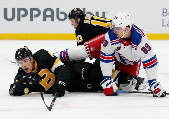 Nov 29, 2019; Boston, MA, USA; Boston Bruins center Charlie Coyle (13) gets tangled up with New York Rangers left wing Pavel Buchnevich (89) during the first period at TD Garden. Mandatory Credit: Winslow Townson-USA TODAY Sports