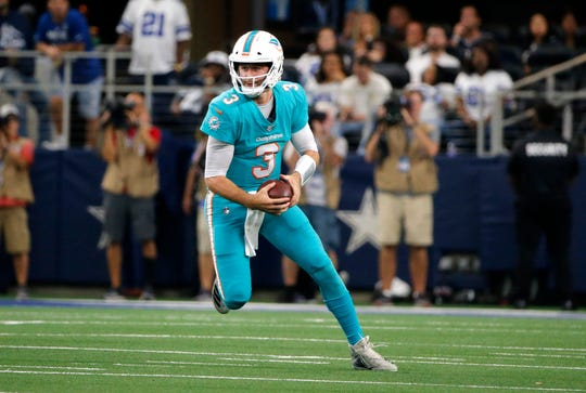 Miami Dolphins quarterback Josh Rosen (3) keeps the ball and gains yardage on a run in the first half of a NFL football game against the Dallas Cowboys in Arlington, Texas, Sunday, Sept. 22, 2019. (AP Photo/Michael Ainsworth)