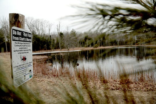 Signs from the Michigan Department of Community Health warn to not eat fish from Clark's Marsh in Oscoda on the grounds of the decommissioned Wurtsmith Air Force Base due to unsafe levels of PFCs in fish and the surface water. The water tested at least 5,000 ppt for total PFAS due to the contamination at the former base.