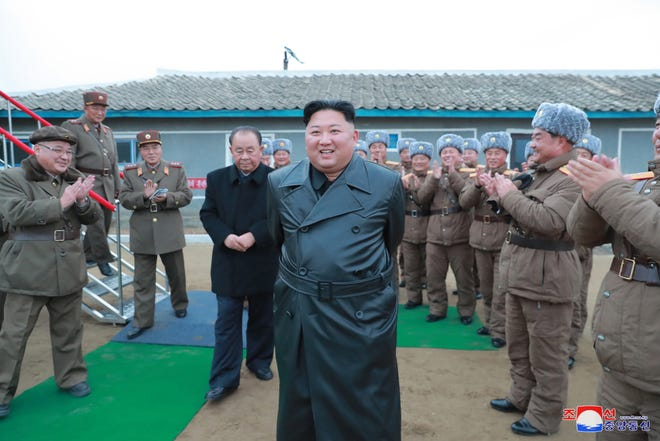 An undated photo released by the official North Korean Central News Agency (KCNA) shows Kim Jong Un inspecting the test-fire of the super-large multiple launch rocket system conducted by the Academy of Defence Science, at an undisclosed location in North Kore