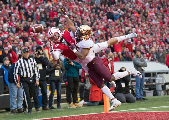 Minnesota defensive back Coney Durr defends the pass intended for Wisconsin wide receiver Danny Davis III (6) during the first quarter of their 2018 game at Camp Randall Stadium.