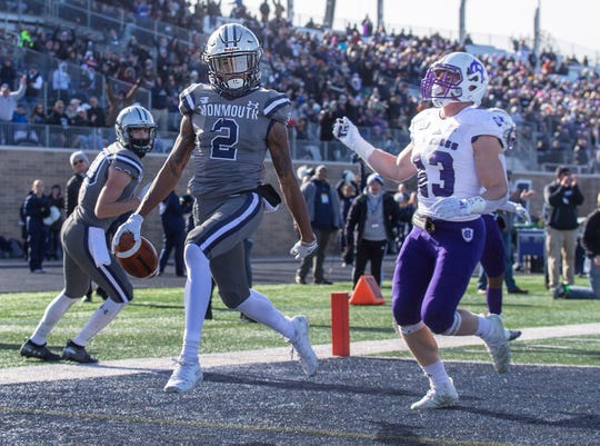 Monmouth Lonnie Moore IV celebrates after scoring Monmouth's first touchdown against Holy Cross Saturday in a FCS first-round playoff game.