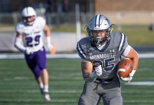 Monmouth Pete Guerriero heads down the left sideline for long yardage during second half action.Monmouth football against Holy Cross in the first round of the FCS Playoffs.