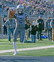 Monmouth receiver Lonnie Moore scores against Holy Cross in a first-round FCS Playoff game last Saturday at Kessler Field in West Long Branch.