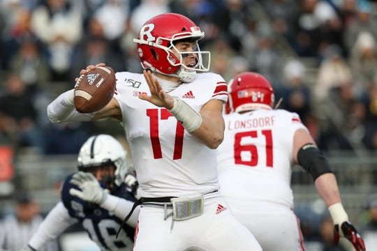 Rutgers Scarlet Knights quarterback Johnny Langan (17) throws a pass during the first quarter against the Penn State Nittany Lions at Beaver Stadium.