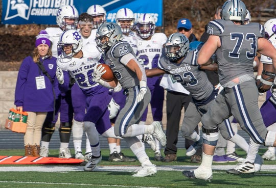 Monmouth running back Pete Guerriero races 68 yards for a touchdown Saturday against Holy Cross in a FCS first-round playoff game