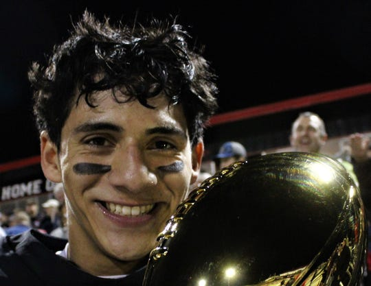 Hawley quarterback Xavier Rodela's smile is as bright as the stadium lights on the gold football awarded Hawley after its 22-21 victory Friday over Sundown at Colorado City. Rodela threw a touchdown pass with 2:44 to play to bring his team to within 21-20, and the Bearcats ran in a 2-point conversion for the win.