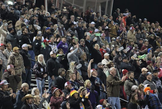 Hawley fans are on their feet and making noise in the final minute of Friday's game against Sundown at Wolf Stadium in Colorado City. Their Bearcats held off the Roughnecks 22-21 to avenge last year's 37-36 loss to Sundown in the state playoffs.