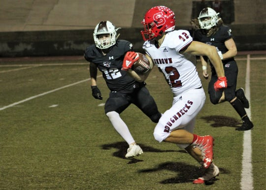 Sundown's Johnny Acevedo (12) gains yards down the home sideline against Hawley on Friday at Wolf Stadium in Colorado City. Sundown scored three times in the first half, all on touchdown passes to lead 21-14 at halftime. Nov. 29 2019