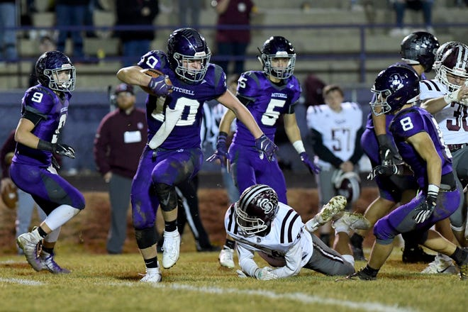 Mitchell's Tyler Mckinney avoids a tackle from Swain County's Thomas Allen during their third-round NCHSAA playoff game at Mitchell High School on Nov. 29, 2019.