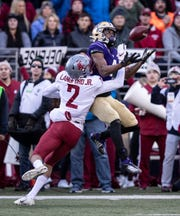 Washington State cornerback Derrick Langford, left, breaks up a pass intended for Washington wide receiver Terrell Bynum during the first half of an NCAA college football game, on Friday, Nov. 29, 2019 in Seattle. (AP Photo/Stephen Brashear)